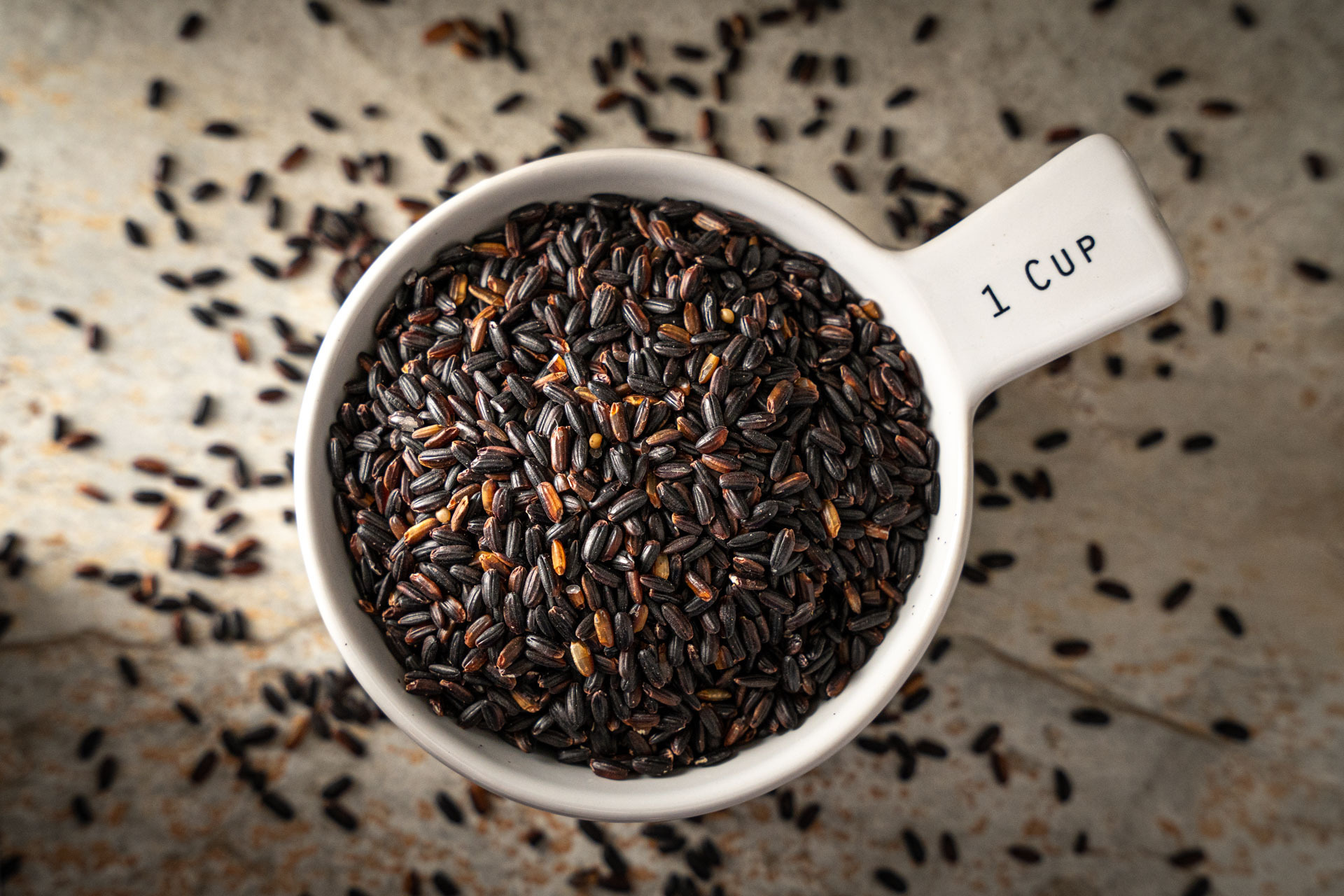 Lundberg Organic Black Pearl Rice in measuring cup