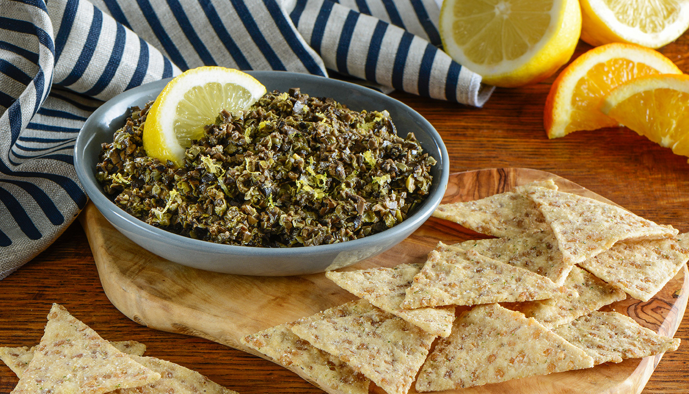Citrus Tapenade in bowl with Lundberg rice chips