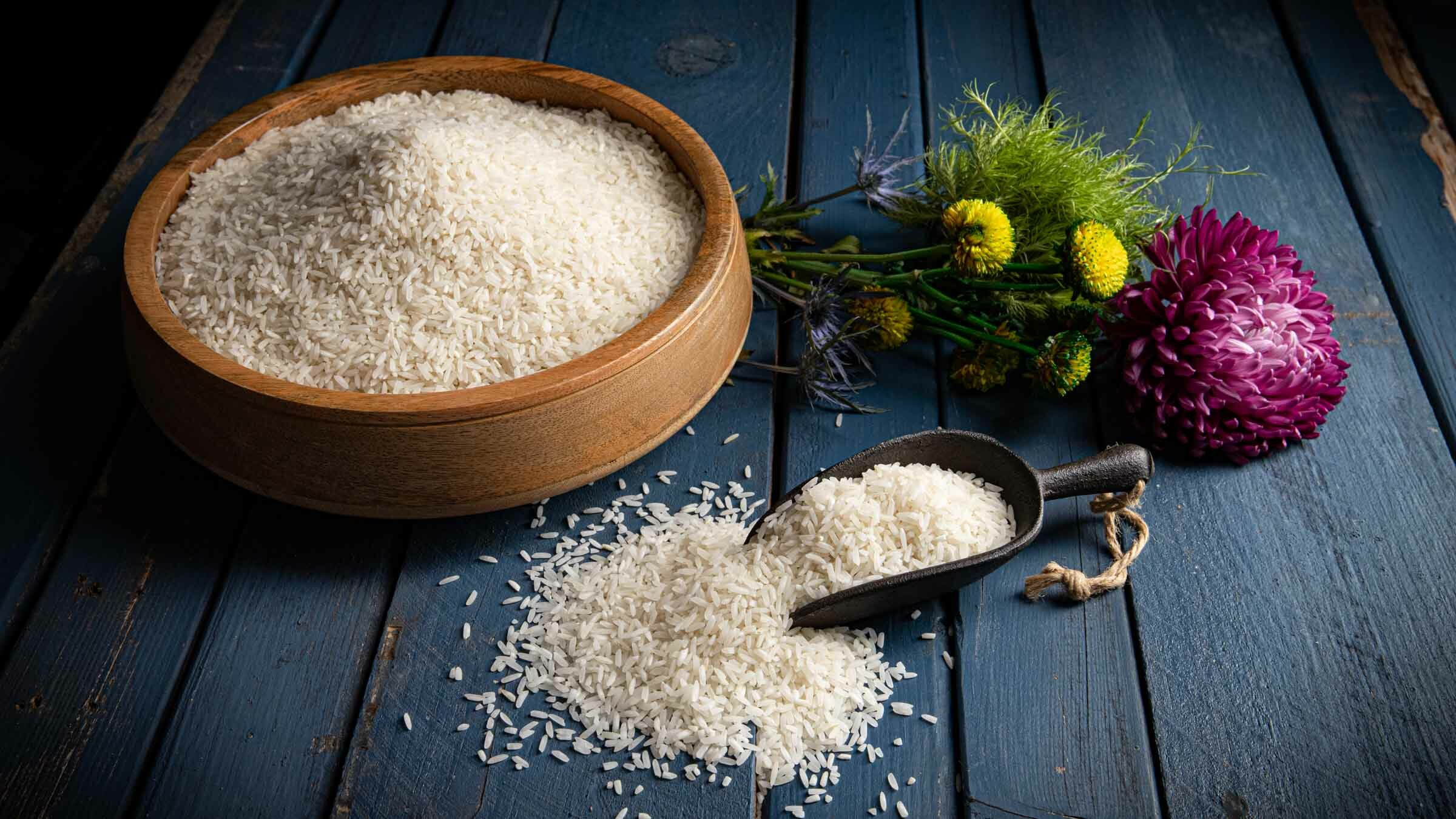 White Basmati rice on table with bowl and scoop