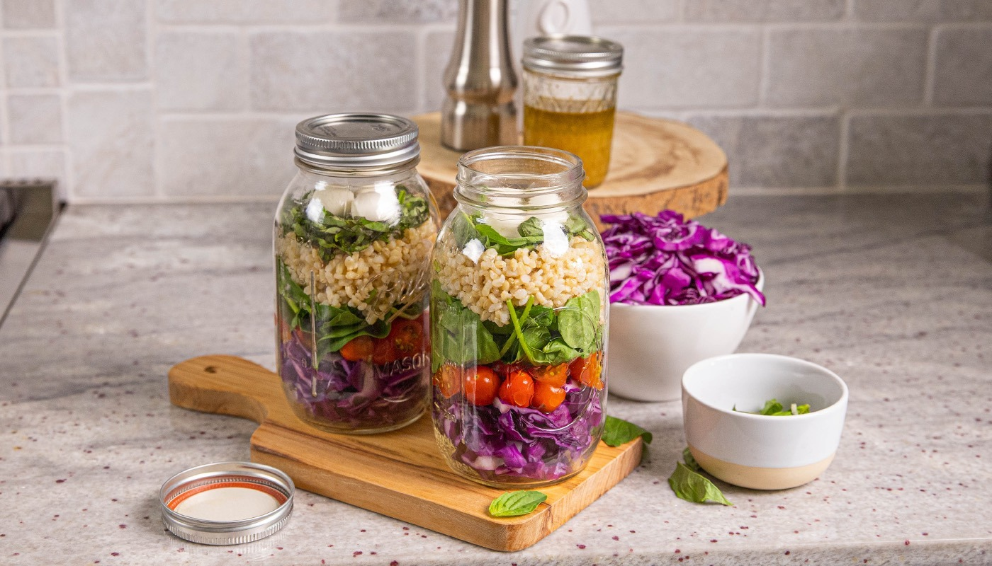 Jars full of hearty caprese rice salad