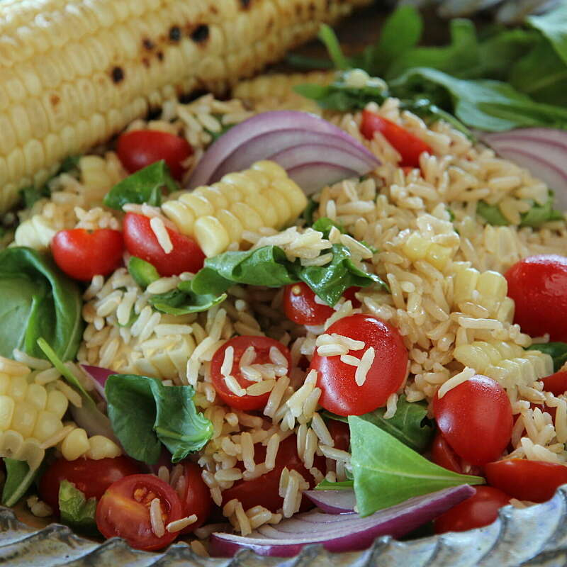 Summer Salad with Corn, Rice, Cherry Tomatoes, and Arugula