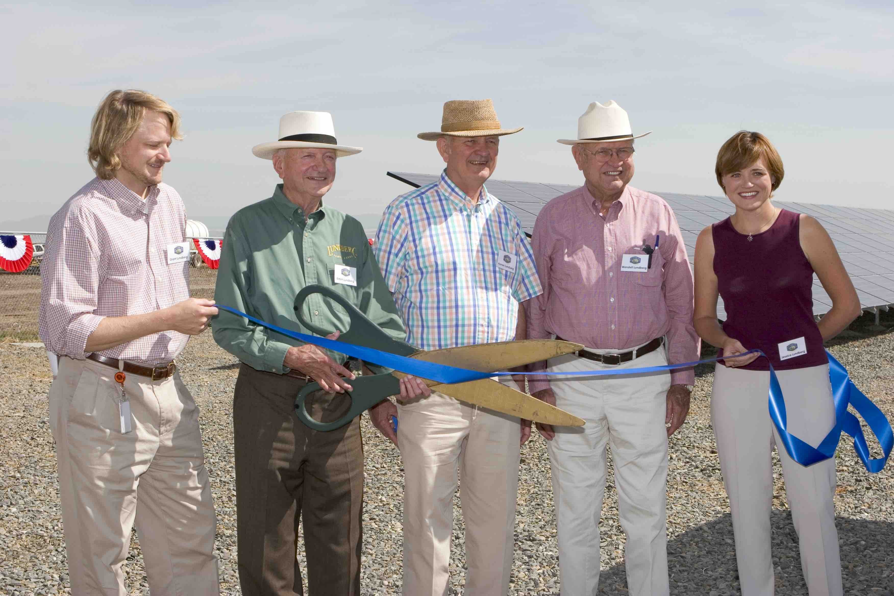 Grant, Eldon, Homer, Wendell, and Jessica Lundberg at a ribbon cutting for the new solar panels.