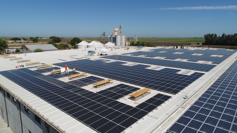 Solar panels are installed atop Lundberg's Snacks facility.